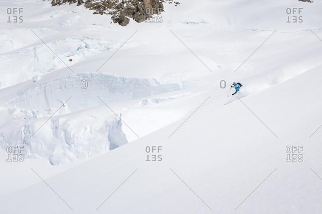 Denali, Alaska, United States - December 12, 2017: A mountaineers is skiing down a glacier slope at 14.000 feet on Denali, Alaska