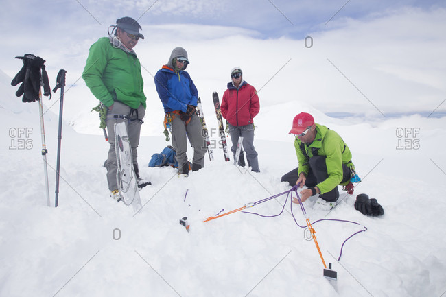 Denali, Alaska, United States - December 12, 2017: Denali National Park Service Ranger Dave Weber is showing rope techniques to Phunuru Sherpa. In 2009 the Nepalese mountain guide was the first to take part in the Sherpa Exchange Program, organized by the Khumbu Climbing Center to share mountaineering and rescue insights between Alaska and the Himalaya. In 2016 Phunuru came back to Denali