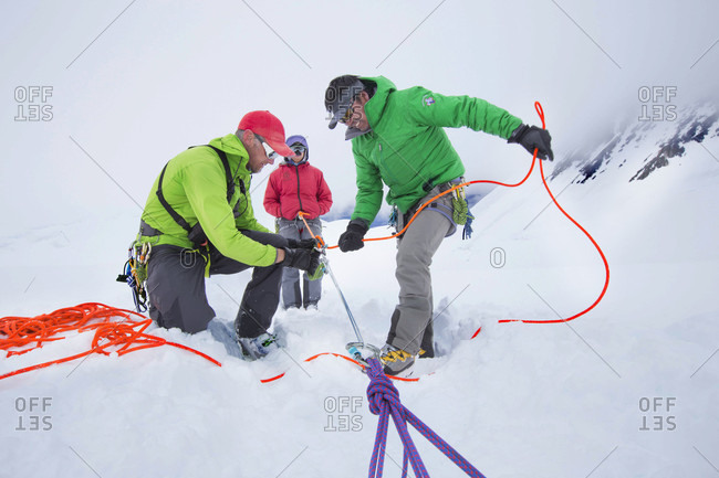 Denali, Alaska, United States - May 31, 2017: Denali National Park Service Ranger Dave Weber is showing rope techniques to Phunuru Sherpa. In 2009 the Nepalese mountain guide was the first to take part in the Sherpa Exchange Program, organized by the Khumbu Climbing Center to share mountaineering and rescue insights between Alaska and the Himalaya. In 2016 Phunuru came back to Denali