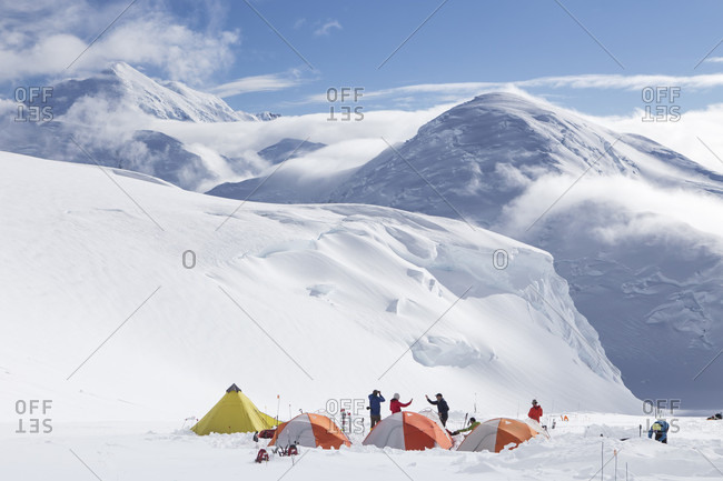 Denali, Alaska, United States - December 12, 2017: Mountaineers meeting each other in a camp with tents at 12.000 feet on Denali, Alaska