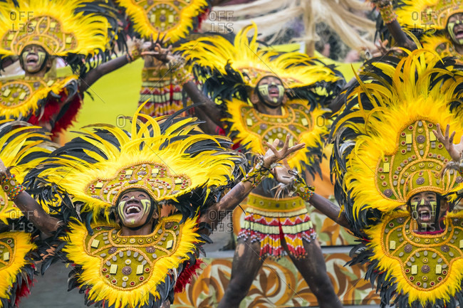 Iloilo City, Western Visayas, Philippines - January 25, 2015: Ati warriors from Tribu Ilonganon of Jalandoni Memorial National High School react during 2015 Dinagyang Festival