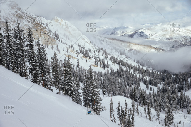Solitude, Utah, USA - February 13, 2013: A woman making some fresh turns on a snowy mountain