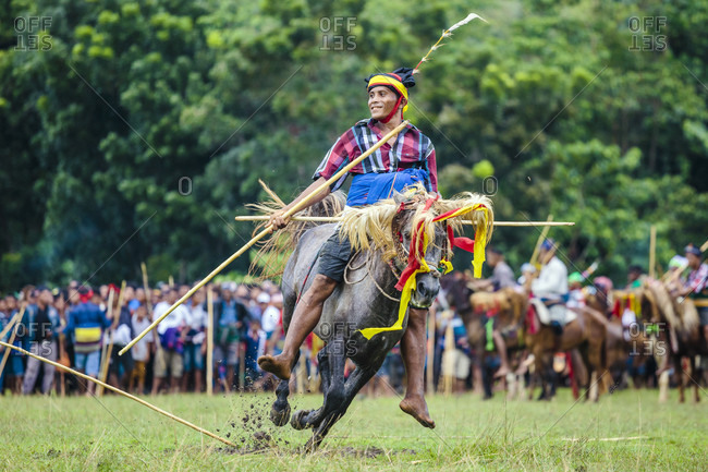 Sumba, Indonesia - June 5, 2017: Man with spear participating in Pasola Festival