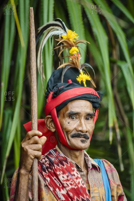 Sumba, Indonesia - December 12, 2017: Portrait of senior man wearing traditional costume, Pasola festival