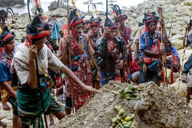 Sumba, Indonesia - December 12, 2017: Group of men wearing traditional costumes at ceremony before Pasola festival