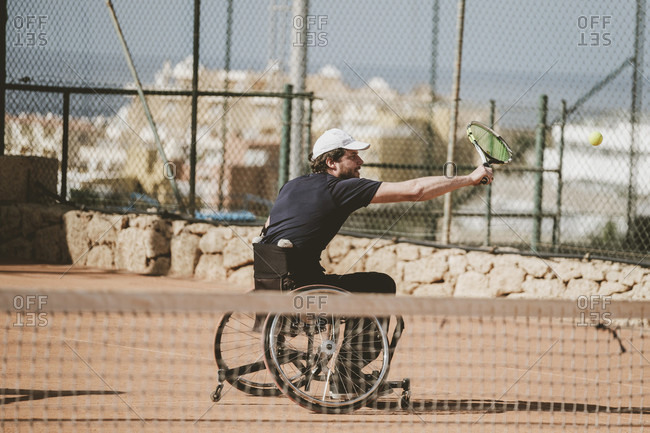 Tenerife, Canary Island, Spain - February 9, 2017: Mid adult Austrian paralympic tennis player playing on tennis court