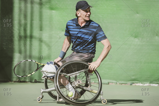 Tenerife, Canary Island, Spain - February 9, 2017: Mature Austrian paralympic tennis player on tennis court