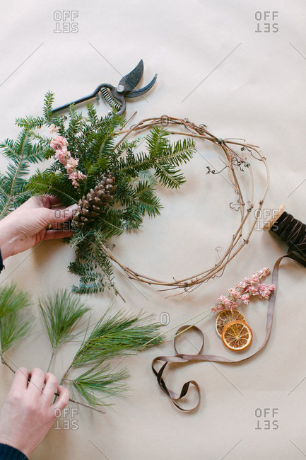 Woman making a holiday wreath