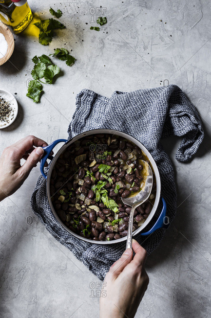 Cooked pinto beans, heirloom beans on a marble surface