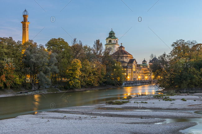 Munich, Germany - October 13, 2017: River Isar and Muellersches Volksbad in autumn