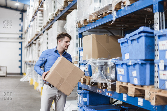 Man working in warehouse holding box