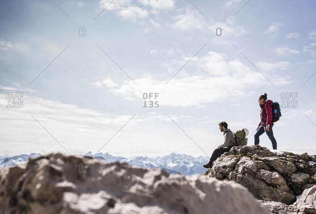 Germany- Bavaria- Oberstdorf- two hikers on rock in alpine scenery