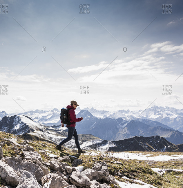 Germany- Bavaria- Oberstdorf- hiker walking in alpine scenery