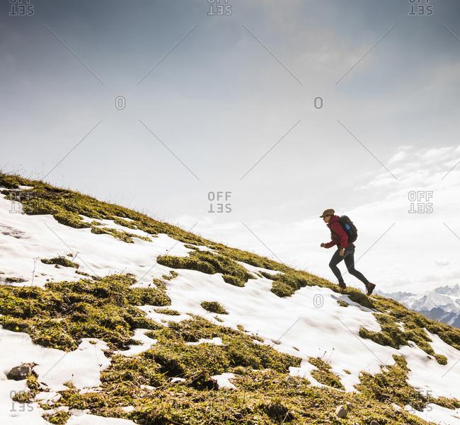 Germany- Bavaria- Oberstdorf- woman walking up alpine meadow