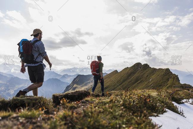 Germany- Bavaria- Oberstdorf- two hikers walking on mountain ridge
