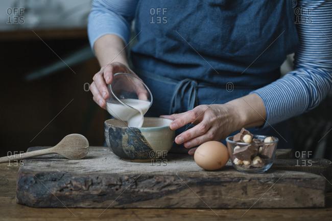 Woman preparing dessert- partial view