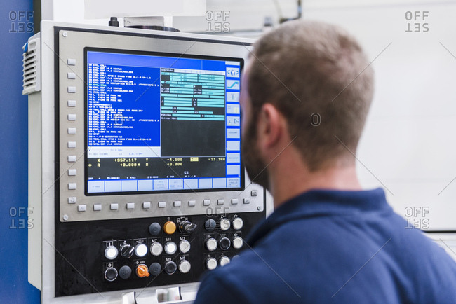 Man looking at screen in industrial factory