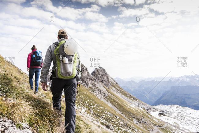 Germany- Bavaria- Oberstdorf- two hikers walking in alpine scenery