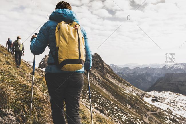 Germany- Bavaria- Oberstdorf- hikers walking in alpine scenery