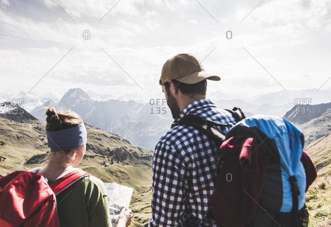 Germany- Bavaria- Oberstdorf- two hikers with map in alpine scenery