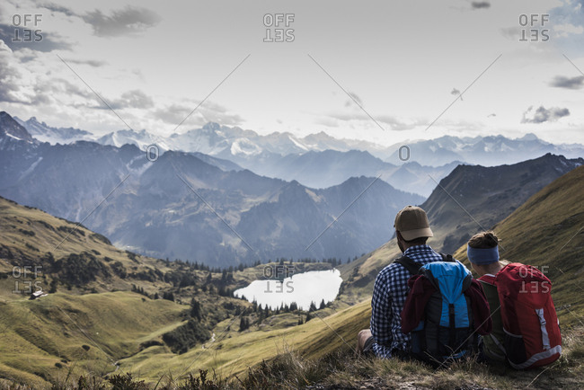 Germany- Bavaria- Oberstdorf- two hikers sitting in alpine scenery