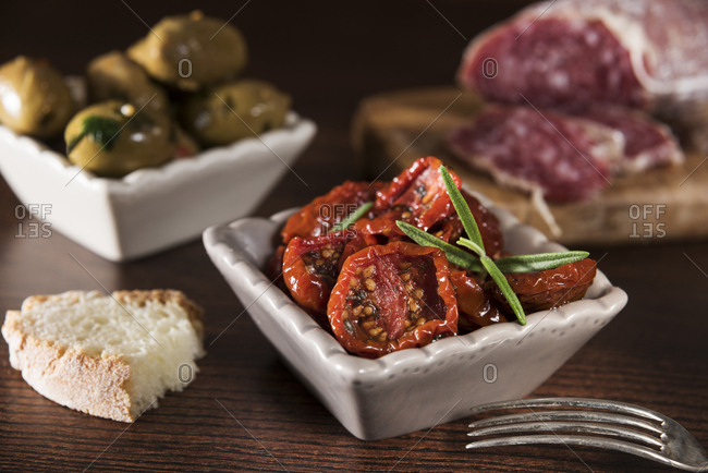 Antipasti- pickled olives- pickled tried tomato- olive bread- salami
