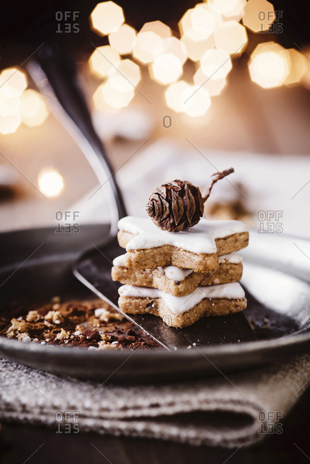 Stack of three cinnamon stars on plate