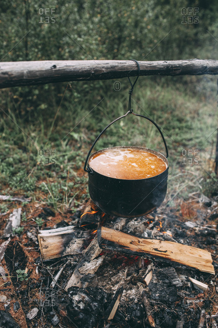 Cauldron over camp fire