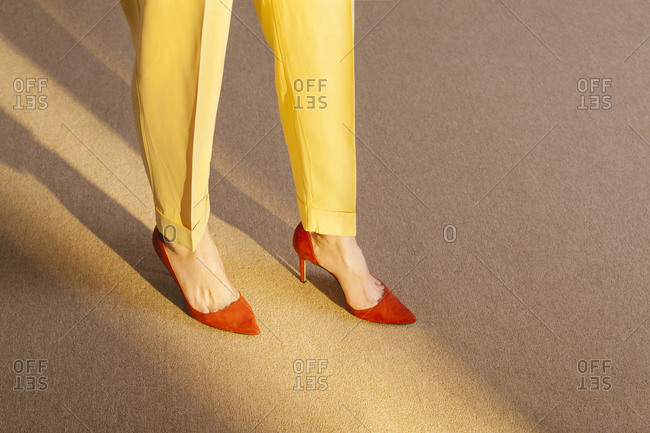 Leg and feet of woman with yellow suit