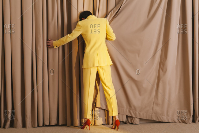 Woman with yellow suit with back turned