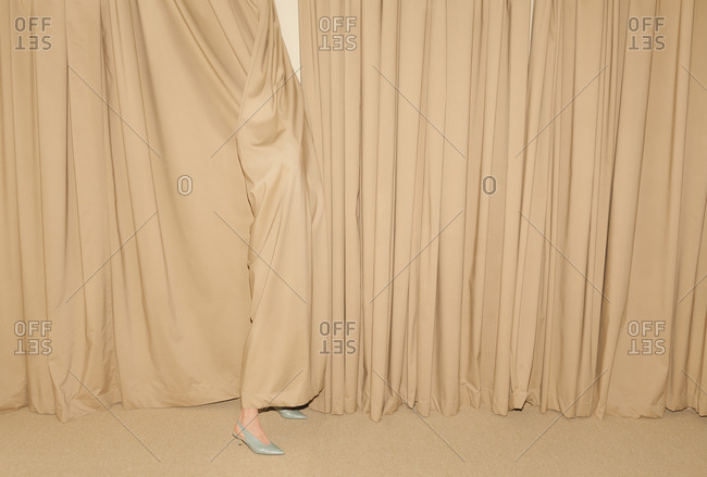 Woman wrapped in curtain
