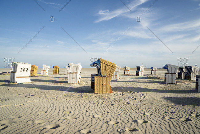 Germany - July 18, 2015: Sandy beach with hooded beach chairs