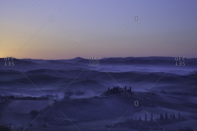 Val d'Orcia, Orcia valley, Tuscany, Italy - April 24, 2017: Foggy dawn