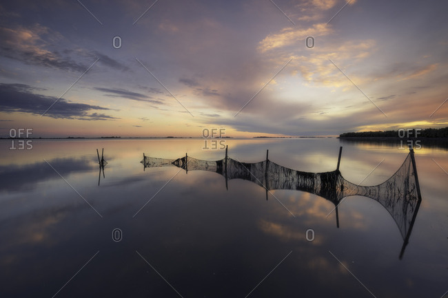 Fish nets in the Grado lagoon at sunset, Friuli Venezia Giulia, Italy