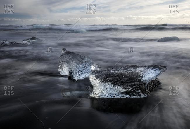Ice block from Vatnajokull glacier on the beach, Jokulsarlon, Iceland