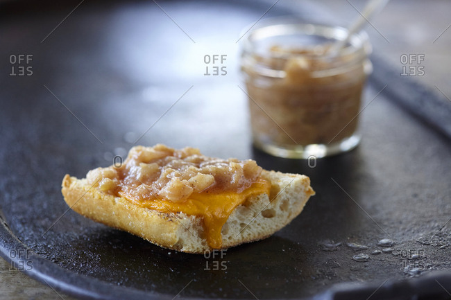 Pear compote and melted cheese on a slice of baguette