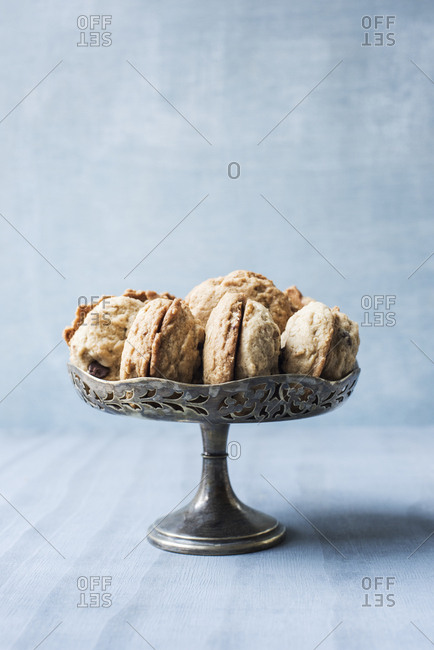 Still life of cookies in tarnished silver bowl