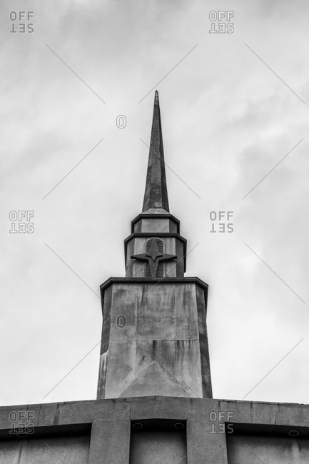 Church steeple with decorative star on building exterior