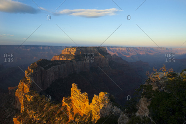 Looking out over a ridge line and a canyon at sunset
