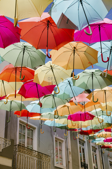 Umbrellas hanging above streets