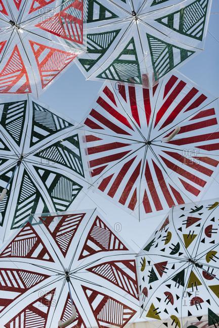 Translucent umbrellas above street