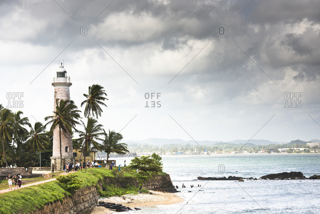Galle, Sri Lanka - July 1, 2017: Tourists visiting Galle Lighthouse during cloudy weather, Galle, Sri Lanka