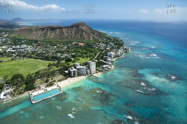 Aerial view coastline with Diamond Head and east end of Waikiki, Honolulu, Hawaii, USA