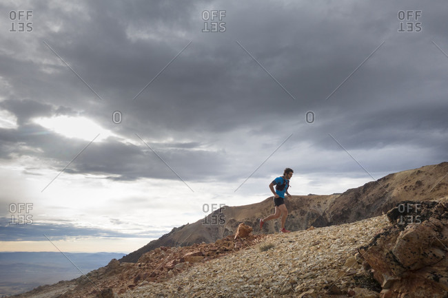 single trail runner climbing Cerro Nahuel Pan mountain in Esquel, Chubut Province, Patagonia, Argentina