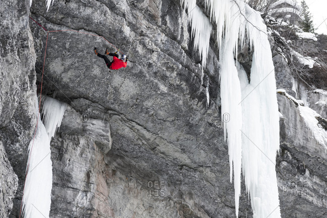 A man mixed ice climbing a difficult route called P51 Mustang, rated M14, on his second try in the Vail Amphitheater, Vail, Colorado.
