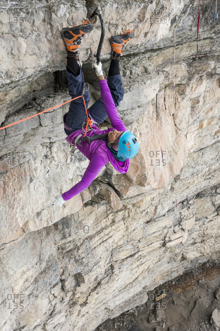 A woman climber becoming the first woman to climb A difficult mixed ice climb called P51 Mustang, rated M14 in the Vail Amphitheater, Vail, Colorado.