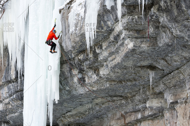 A man mixed ice climbing a route called King Cobra, rated M10 in the Vail Amphitheater, Vail, Colorado.