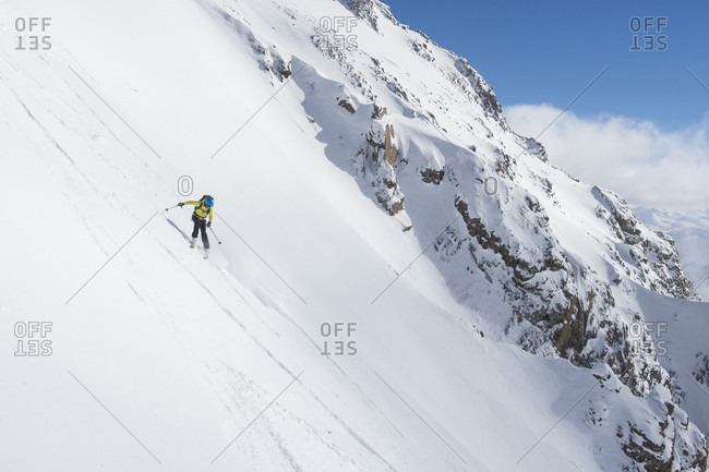 Woman backcountry skiing above Ophir Pass, San Juan National Forest, Silverton, Colorado, USA