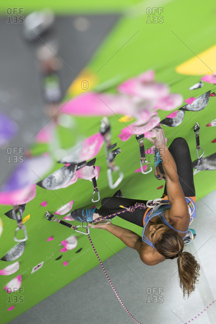 Female climber training on climbing wall, Louisville, Colorado, USA