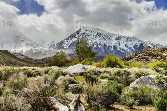 Beautiful natural scenery with desert and snow-covered mountains of Sierra Nevada from The Buttermilks, Bishop, California, USA